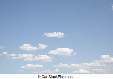 Pale blue sky with clouds - natural background