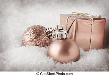 Pale Pink Christmas Decorations in Snow - An arrangement of...