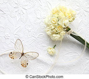pale yellow flowers with butterfly
