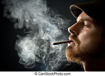 palenie, brodaty człowiek