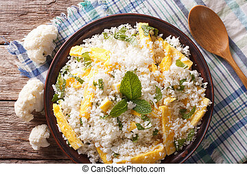 Paleo Food: Cauliflower rice with eggs closeup. horizontal...