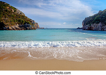 Paleokastritsa beach on Corfu, Greece, looking out between ...