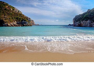 Paleokastritsa beach on Corfu, Greece, looking out between...