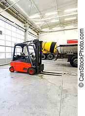 Palette lifter - Red forklift vehicle in truck service...