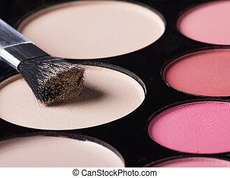 Palette of colorful eye shadows.