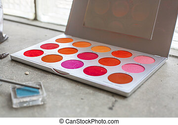 palette of makeup colors in red