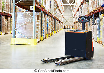 Pallet truck at warehouse
