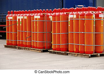 red gas cylinders - pallets of red gas cylinders