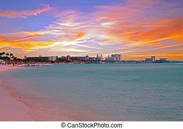 Palm Beach on Aruba island at sunset
