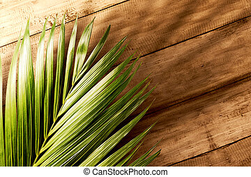 Palm branches with green leaves on wooden table. Palm Sunday concept