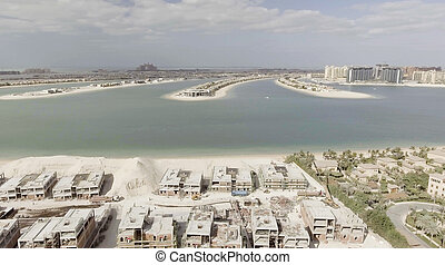 Palm Jumeirah Island in Dubai. Aerial view on a sunny afternoon