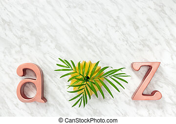 Palm leaves and metal letters decor