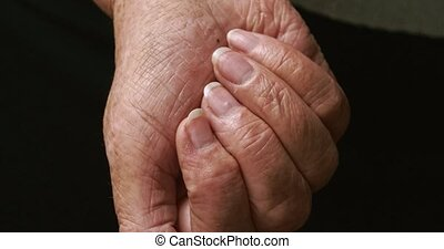 Palm of old woman with set of different drugs