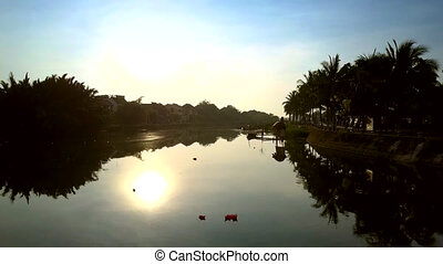 palm silhouettes and sun reflect in lazy river - fantastic...