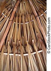 Palm tree leaves in sunroof palapa hut roofing - Palm tree...