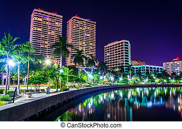 Palm trees along the Intracoastal Waterway and the skyline at ni