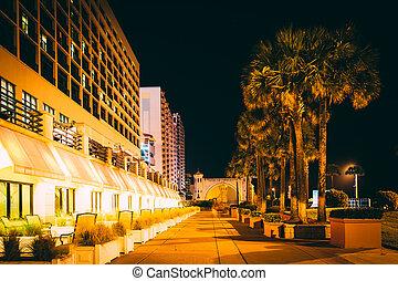 Palm trees and hotels at night, in Daytona Beach, Florida.