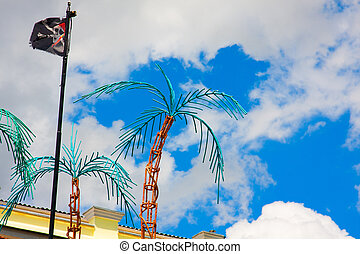 palm trees and pirate flag