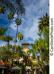 Palm trees and the exterior of the Mission Inn, in...