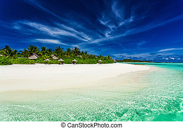 Palm trees over stunning lagoon and white sandy beach