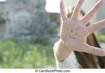 palm with smile, happiness concept, blurred photo for background