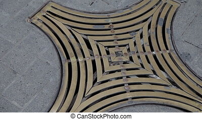Palma de Mallorca, Lattice on a street drain. - Palma de...