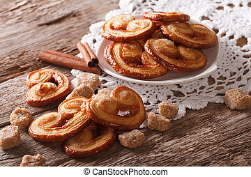 Palmiers biscuits with sugar and cinnamon close-up, ...