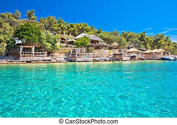 Palmizana turquoise beach and bars by the sea on Pakleni Otoci islands,