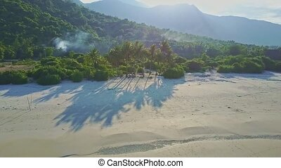 Palms Give Long Shadows on Sand Beach against Jungle -...