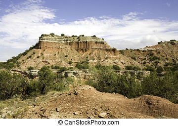 Palo Duro Canyon located in west Texas is the second largest canyon in the US and is sometimes referred to as the Grand Canyon of Texas.  Rock formations including caves and hoodoos provide for this d