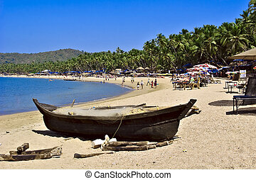 Palolem beach view with fishing boat