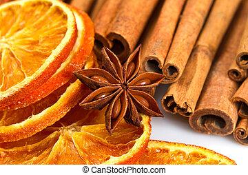 palos, estrelle anís, canela, cortes, naranja, secado