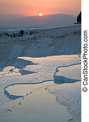 Sunset at Pamukkale's limestone pools also known as Cotton Castles.