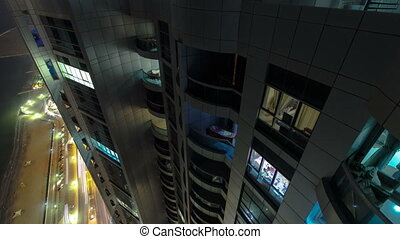 Pan and tilt motion of Ajman from rooftop at night timelapse. Ajman is the capital of the emirate of Ajman in the United Arab Emirates.