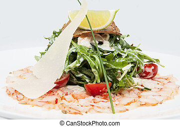 Pan-Asian cuisine - salad greens and shrimp meat on a white ...