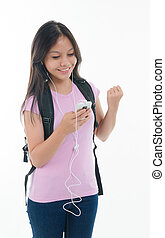 pan asian student listening to music