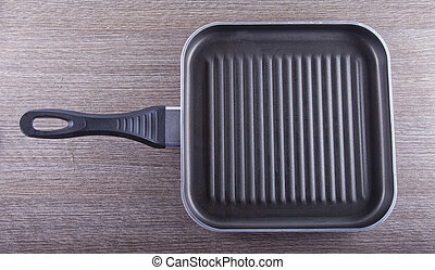 Pan - Close up of a metal frying pan over wooden background