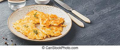 Pan-fried potato pancakes - rosti, kartoffelpuffer, latkes, ...