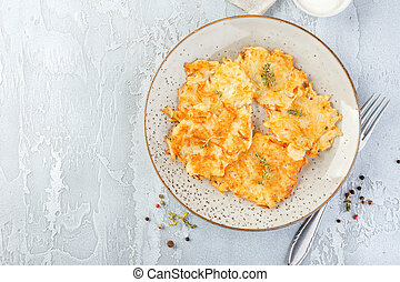 Pan-fried potato pancakes - rosti, kartoffelpuffer, latkes, ...