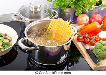 pan of boiling water with spaghetti