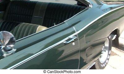 Pan of Classic Green Muscle Car