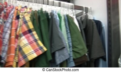 Pan of Colorful Shirts for Sale - Horizontal panning of...