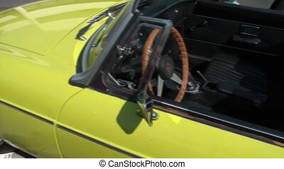 Pan of Small Classic Convertible Car