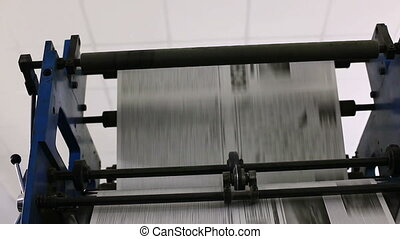 Pan on black and white newspaper production line