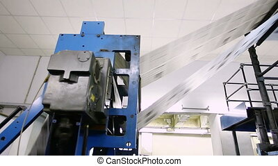 pan on huge newspaper machine in a print shop