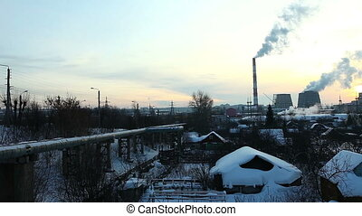Pan on industrial view at sunset - winter in Russia
