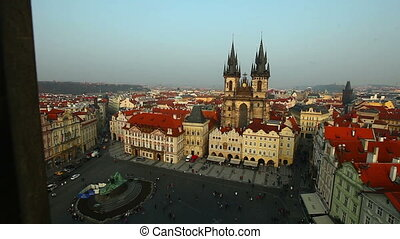 Pan on Prague central square from tower at evening