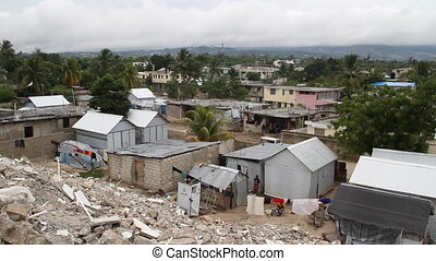 pan over earthquake damaged neighborhoods Port-au-Prince...