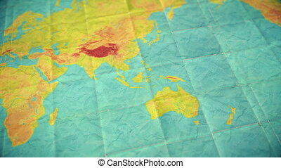 pan over muted vintage colors world map - seamless loopable background - blank version