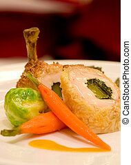 Pan seared chicken supreme crusted with grated coconut, served with vegetables and curry sauce.